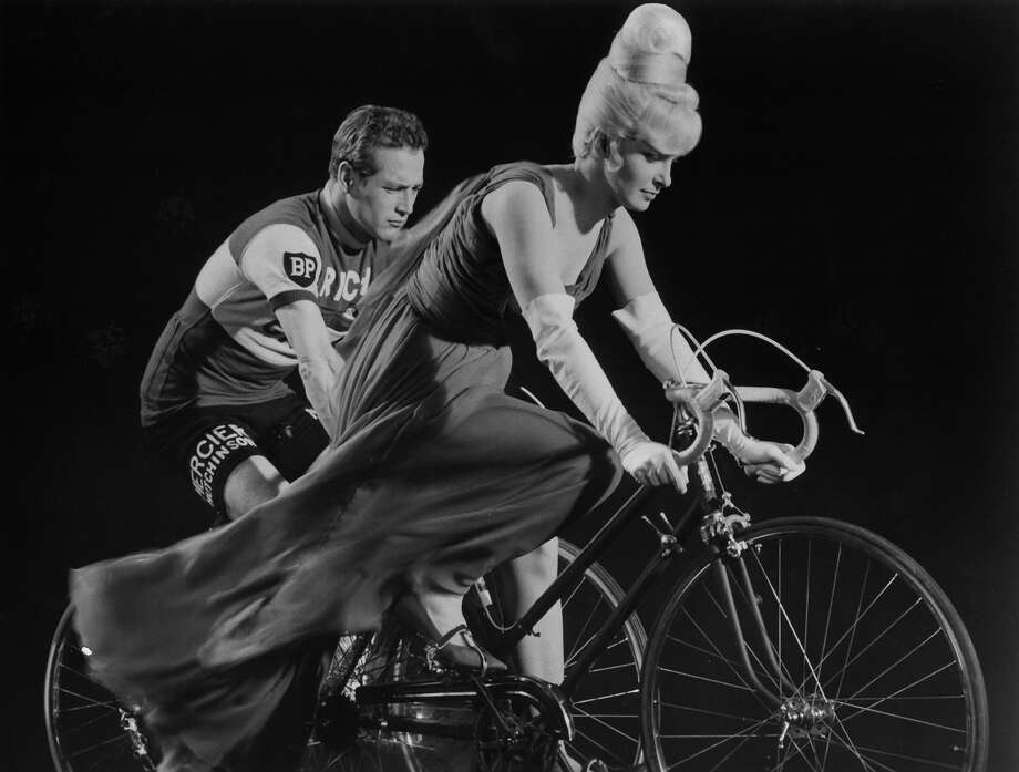 Paul Newman and Joanne Woodward riding bikes in a scene from the film 'A New Kind Of Love', 1964. Photo: Archive Photos, Getty Images / 2012 Getty Images