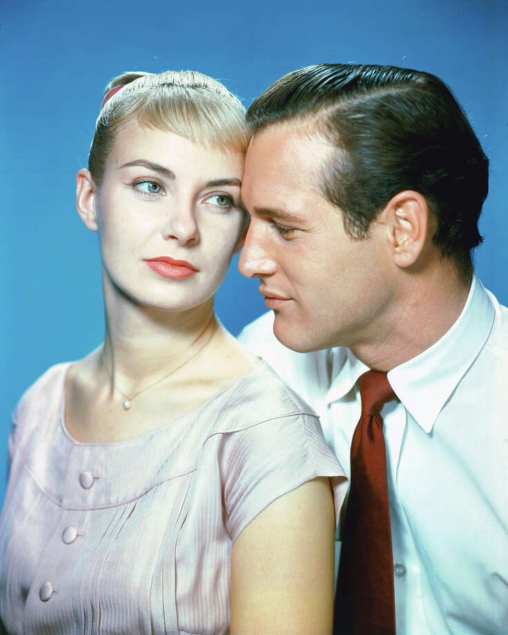 Joanne Woodward, US actress, and Paul Newman (1925-2008), US actor, in a studio portrait, against a blue background, issued as publcity for the film, 'The Long Hot Summer', 1958. The drama, directed by Martin Ritt (1914-1990), starred Woodward as 'Clara Varner', and Newman as 'Ben Quick'. Photo: Silver Screen Collection, Getty Images / 2011 Silver Screen Collection