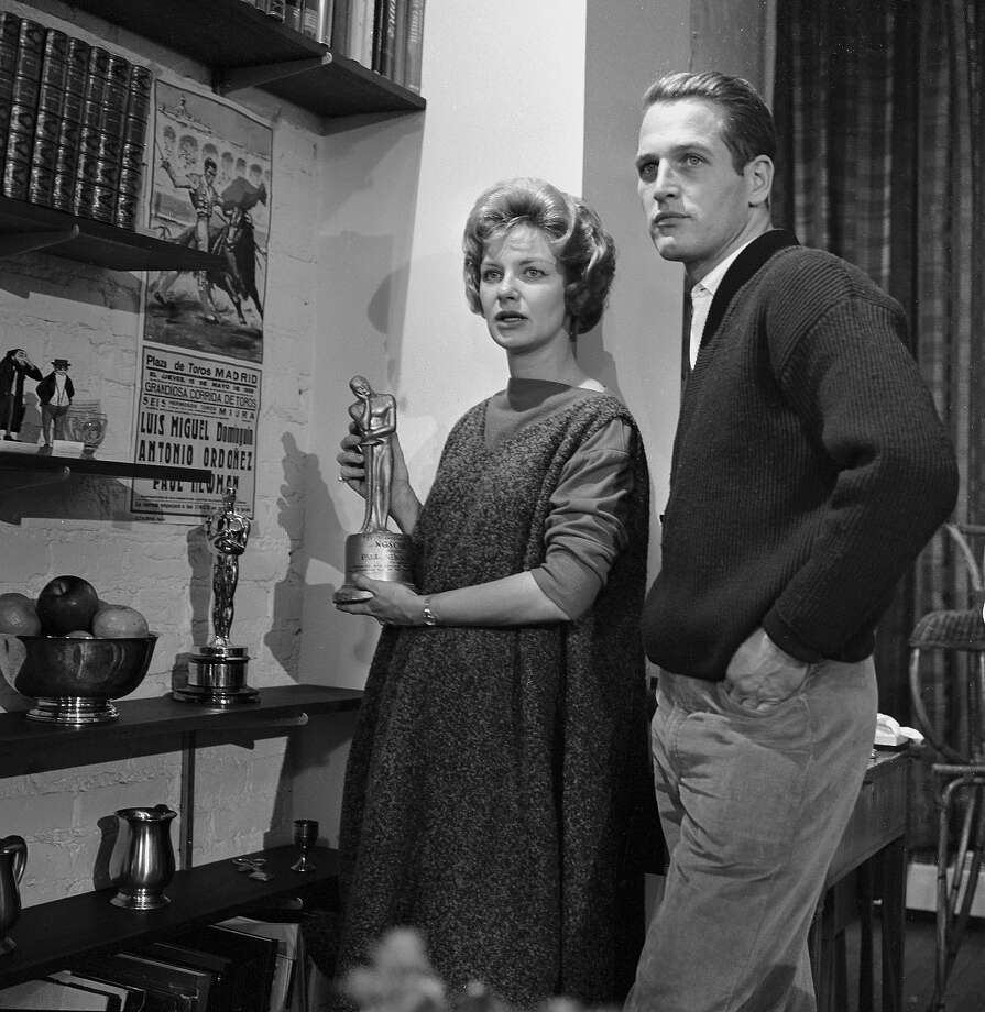 Married American actors Paul Newman (1925 - 2008) and Joanne Woodward being interviewed in their 11th Street home by Edward R. Murrow via camera on the celebrity interview program 'Person To Person,' New York, New York, December 26, 1958. Photo: CBS Photo Archive, Getty Images / 2008 CBS WORLDWIDE INC.