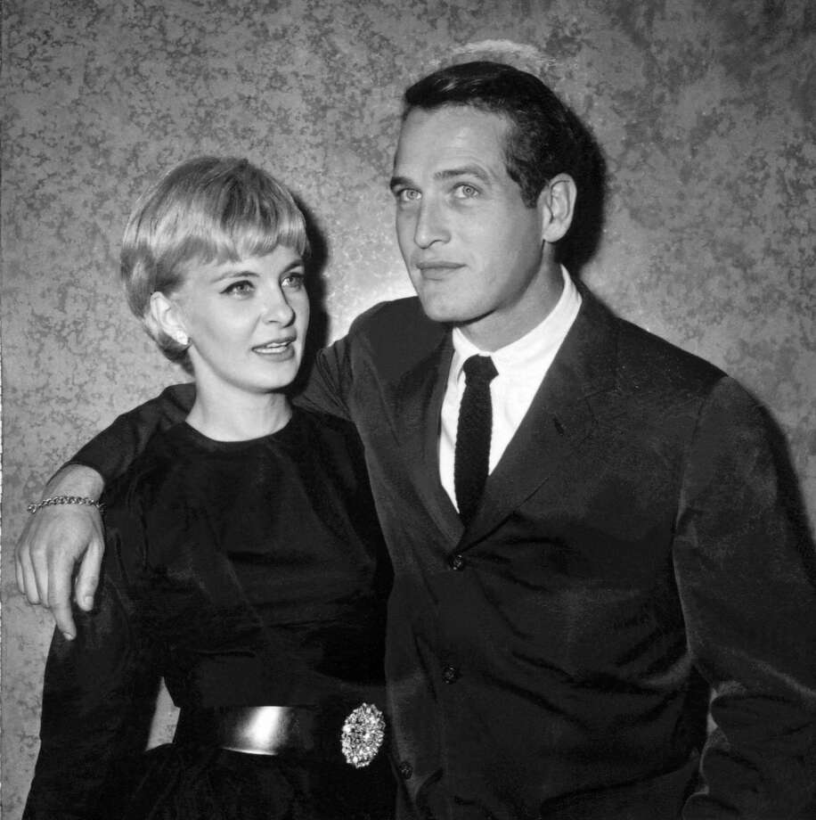 "A file photo dated 13 October 1960 shows US actors Paul Newman (R) and Joanne Woodward in Paris during the presentation of their film ""From the Terrace"". Oscar-winning screen legend and philanthropist Paul Newman has died of cancer at 83, his foundation announced on September 27, 2008. Photo: AFP, Getty Images / 2008 AFP"