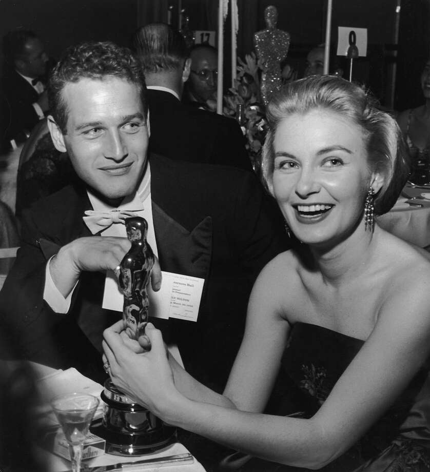 1958:  American actor Joanne Woodward holds her Oscar statuette while sitting next to husband, American actor Paul Newman, during the Governor's Ball, an Academy Awards party held at The Beverly Hilton Hotel, Beverly Hills, California. Woodward won the Best Actress Oscar for director Nunnally Johnson's, 'The Three Faces of Eve.' Photo: Darlene Hammond, Getty Images / Archive Photos