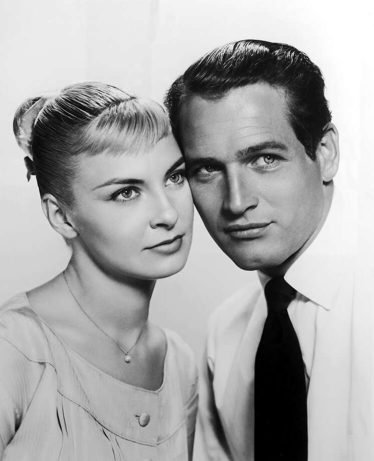 Promotional portrait of married American actors Joanne Woodward and Paul Newman posing cheek to cheek for the film, 'The Long Hot Summer,' directed by Martin Ritt, 1958. Photo: 20th Century Fox, Getty Images / 2002 Getty Images