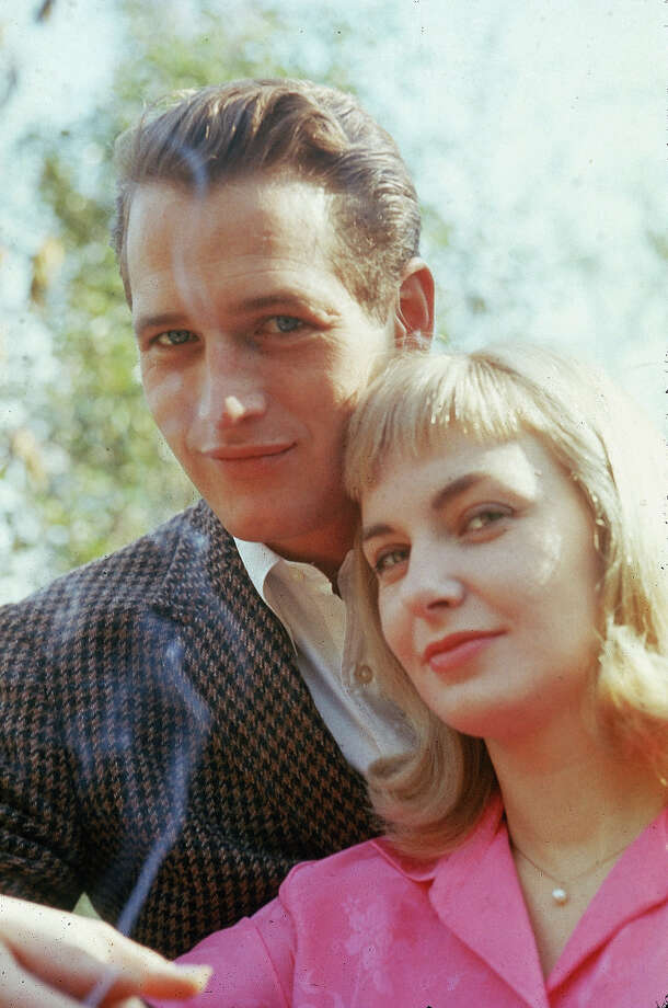 Portrait of married American actors Paul Newman and Joanne Woodward standing outdoors, circa 1962. Photo: Hulton Archive, Getty Images / 2002 Getty Images