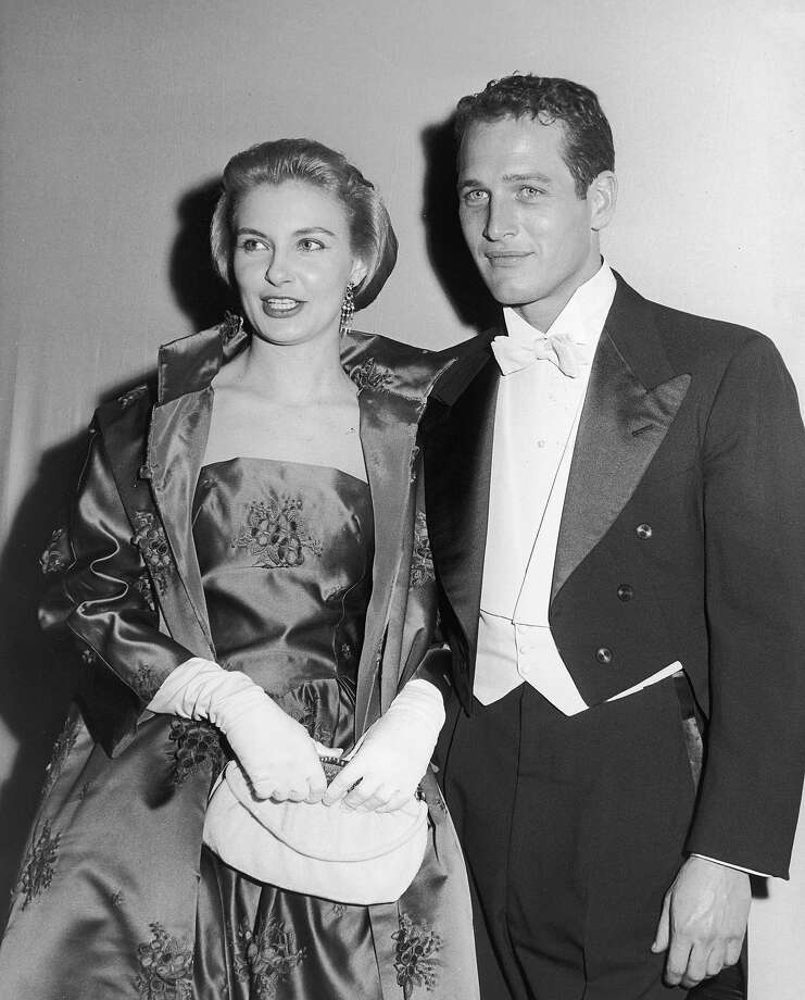 Married American actors Paul Newman and Joanne Woodward pose together wearing formal evening wear while attending the Academy Awards, California, circa 1964. Photo: Bruce Bailey, Getty Images / 2002 Getty Images