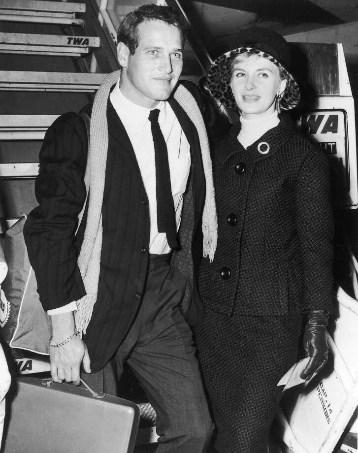 Married American actors Paul Newman and Joanne Woodward board a TWA Superjet airplane bound for Paris, France to shoot the film, 'Paris Blues,' directed by Martin Ritt, New York (now JFK) International Airport October 11, 1960. Photo: Hulton Archive, Getty Images / 2002 Getty Images