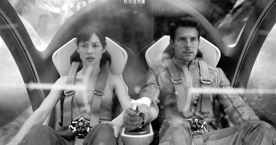 "Jack (Tom Cruise) begins to question his mission on Earth after meeting a mysterious woman (Olga Kurylenko) in ""Oblivion."" Photo: HOEP / Universal Pictures"