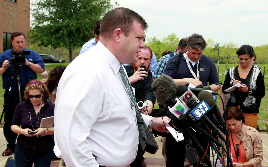 Lt. Justin Lewis, center, PIO of the Kaufman County Sheriff's office announces  that Kim Williams is charged with capital murder Wednesday, April 15, 2013 in Kaufman, Texas.  Williams, the wife of a former North Texas justice of the peace implicated her husband in the shooting deaths of a local district attorney, his wife and an assistant prosecutor, according to court records filed Wednesday. (AP Photo/The Dallas Morning News, David Woo)  MANDATORY CREDIT; MAGS OUT; TV OUT; INTERNET USE BY AP MEMBERS ONLY; NO SALES Photo: David Woo, MBR / The Dallas Morning News