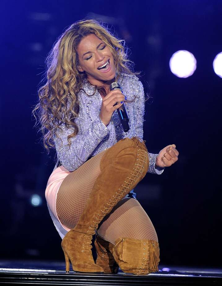 """Singer Beyonce performs on the opening night of her \""""Mrs. Carter Show World Tour 2013\"""", on Monday, April 15, 2013 at the Kombank Arena in Belgrade, Serbia. Beyonce is wearing a lilac hand beaded jacket and boots by Pucci."""