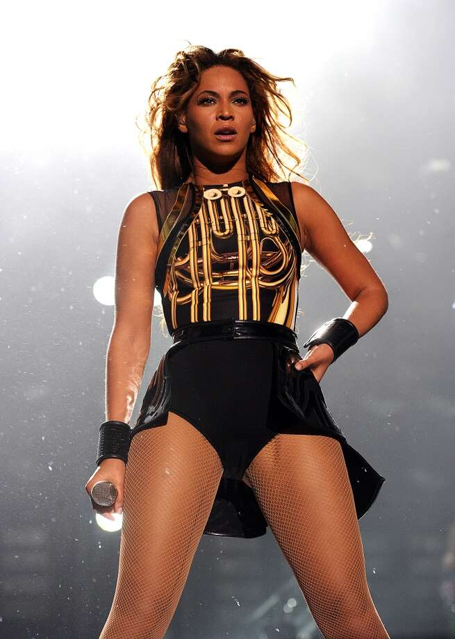"""Singer Beyonce performs on her \""""Mrs. Carter Show World Tour 2013\"""", on Wednesday, April 17, 2013 at the Arena Zagreb in Zagreb, Croatia. Beyonce is wearing a gold and black one-piece with skirt by designer David Koma."""