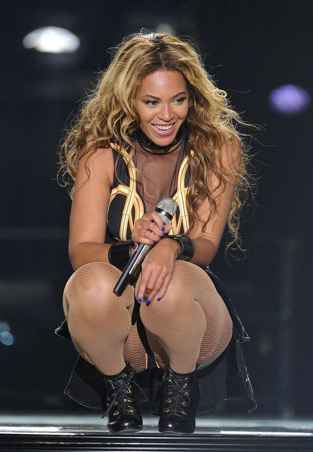 "Singer Beyonce performs on the opening night of her ""Mrs. Carter Show World Tour 2013\"", on Monday, April 15, 2013 at the Kombank Arena in Belgrade, Serbia. Beyonce is wearing a gold and black one-piece with skirt by designer David Koma."
