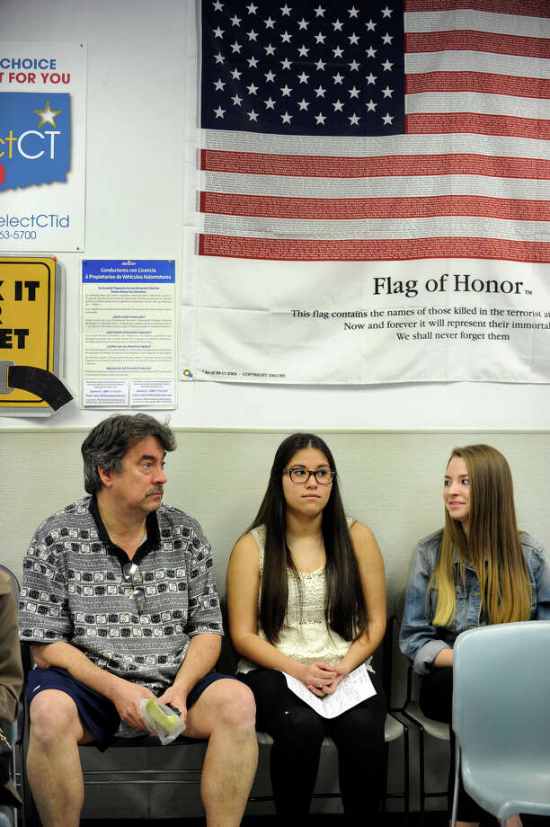 Lisette Burch, of Brookfield, center, who turned 16 in September, waits with her father, Allen Burch and friend Meghan Kendall, 16, to take her driving test at the Dept. of Motor Vehicles in Danbury, Conn., Thursday, April 18, 2013. Photo: Carol Kaliff / The News-Times
