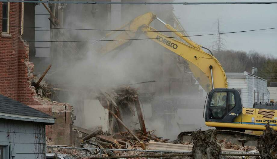St. Patrick's church continues to be razed Thursday April 18, 2013, in Watervliet, N.Y.  (Skip Dickstein/Times Union) Photo: SKIP DICKSTEIN / 0002028A
