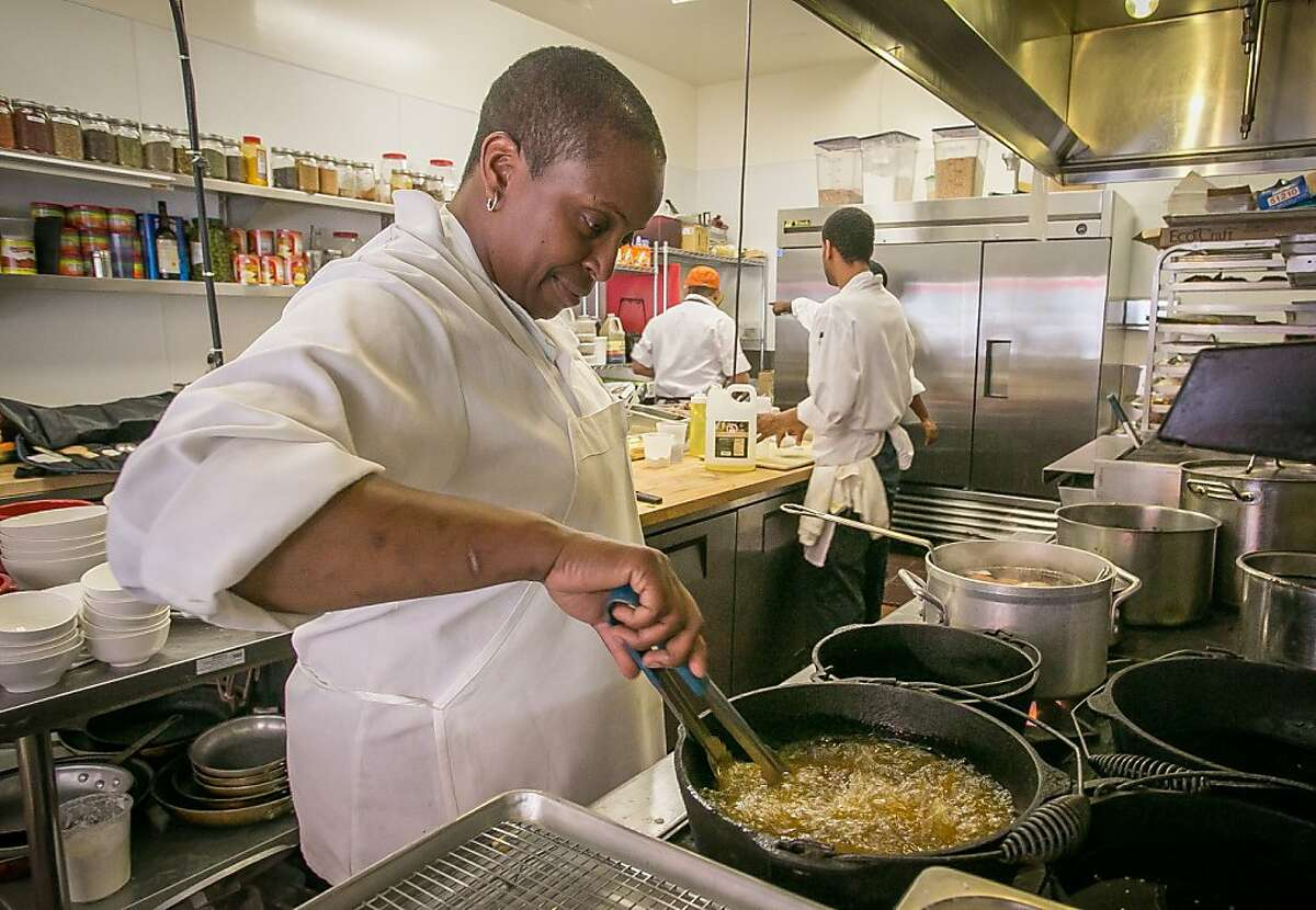 Chef/owner Sarah Kirnon cooks fried chicken at Miss Ollie's in Oakland, Calif., on Thursday, April 11th, 2013.