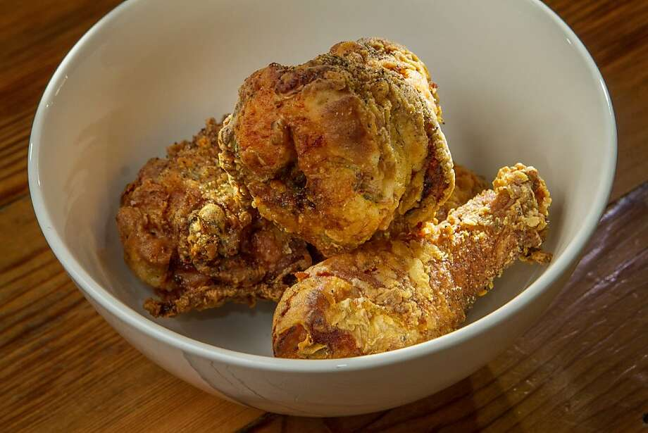 The chicken at Miss Ollie's is fried in rice bran oil and has vinegared herbs stuffed under the skin. Photo: John Storey, Special To The Chronicle