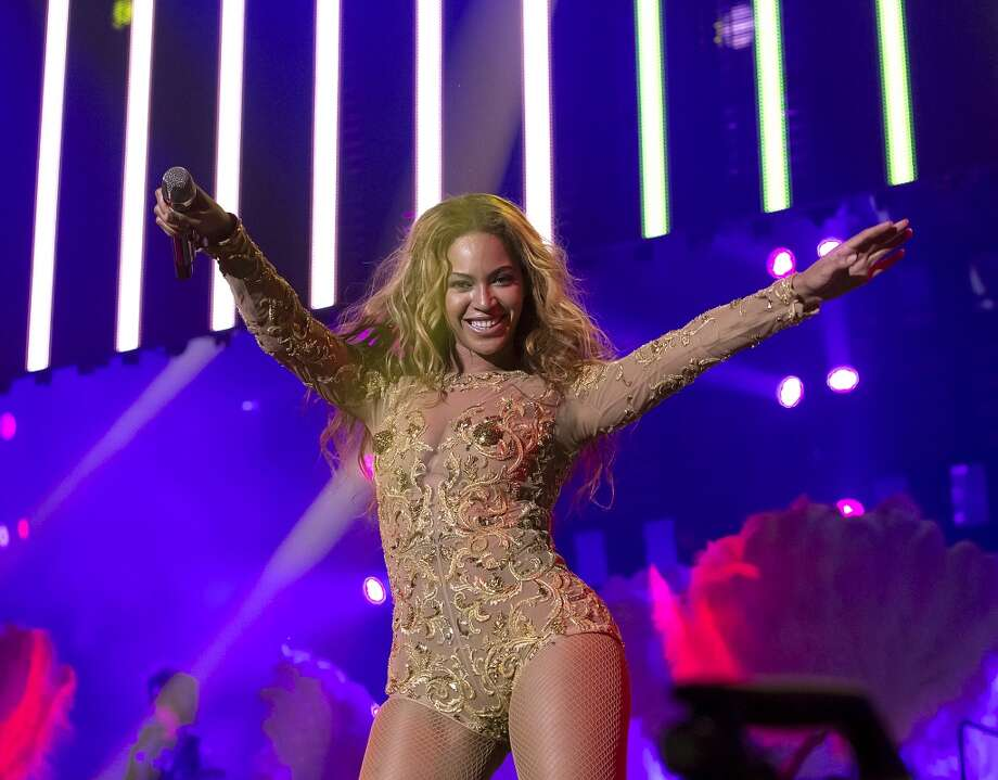 """Singer Beyonce performs on her \""""Mrs. Carter Show World Tour 2013\"""", on Wednesday, April 17, 2013 at the Arena Zagreb in Zagreb, Croatia. Beyonce is wearing a gold embroidered one-piece by designers Ralph & Russo and shoes by Giuseppe Zinotti."""