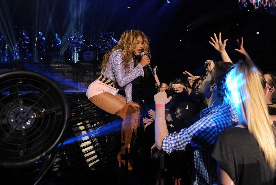 "Singer Beyonce performs on her ""Mrs. Carter Show World Tour 2013\"", on Wednesday, April 17, 2013 at the Arena Zagreb in Zagreb, Croatia. Beyonce is wearing a lilac jacket and boots by Pucci."