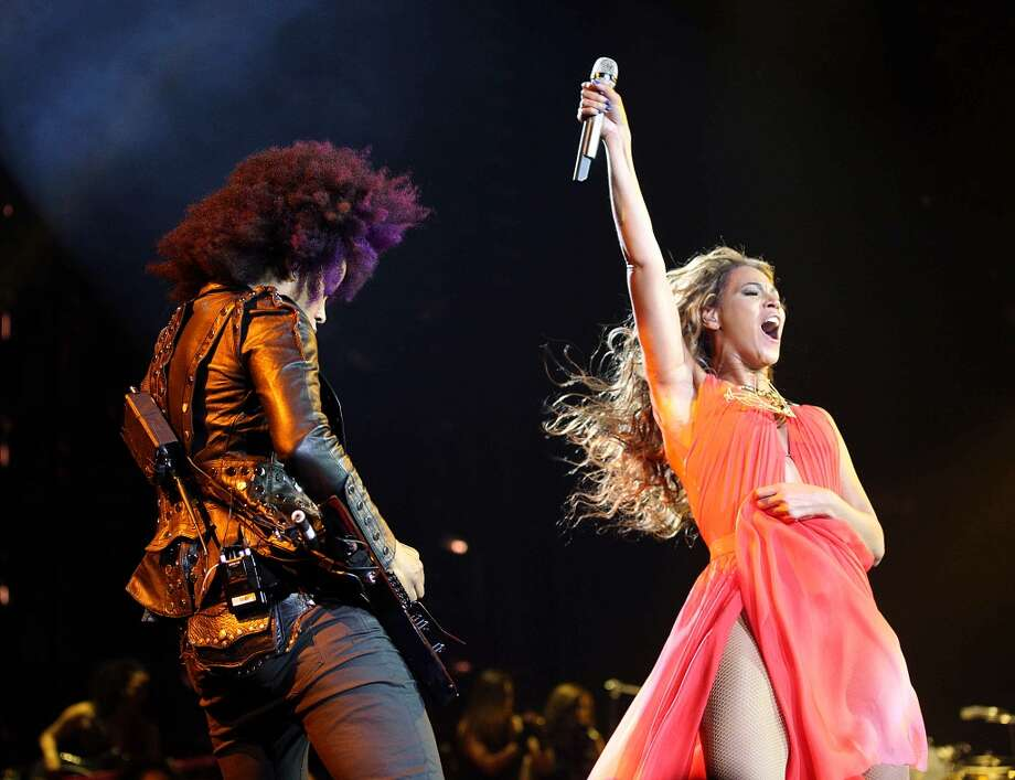 """Singer Beyonce performs with guitarist Bibi on the opening night of her \""""Mrs. Carter Show World Tour 2013\"""", on Monday, April 15, 2013 at the Kombank Arena in Belgrade, Serbia. Beyonce is wearing an outfit by designer Alon Livne."""