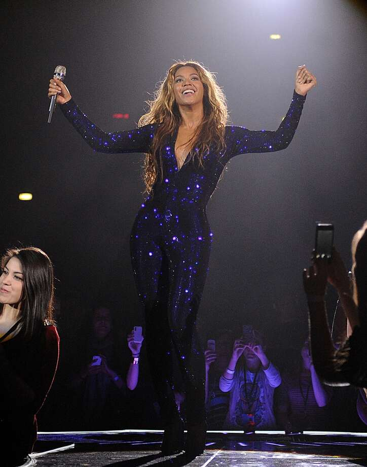"""Singer Beyonce performs on her \""""Mrs. Carter Show World Tour 2013\"""", on Wednesday, April 17, 2013 at the Arena Zagreb in Zagreb, Croatia. Beyonce is wearing a cobalt blue hand beaded jumpsuit by designer Vrettos Vrettakos."""