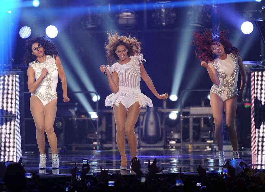 "Singer Beyonce performs on her ""Mrs. Carter Show World Tour 2013\"", on Wednesday, April 17, 2013 at the Arena Zagreb in Zagreb, Croatia. Beyonce is wearing a custom, hand beaded white peplum one-piece by designers Ralph & Russo."