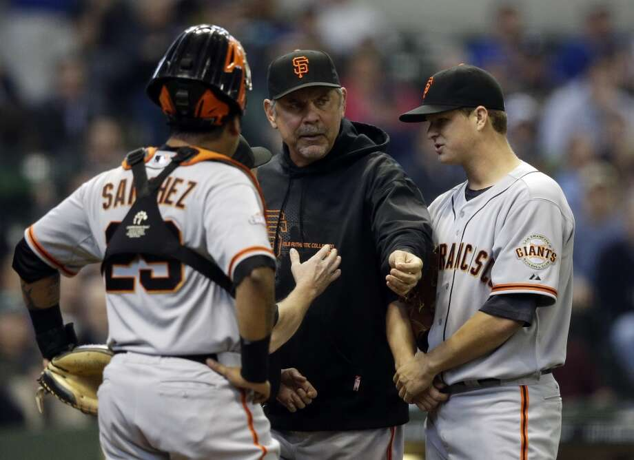 San Francisco Giants manager Bruce Bochy argues a call during the second inning of a baseball game against the Milwaukee Brewers Thursday, April 18, 2013, in Milwaukee.