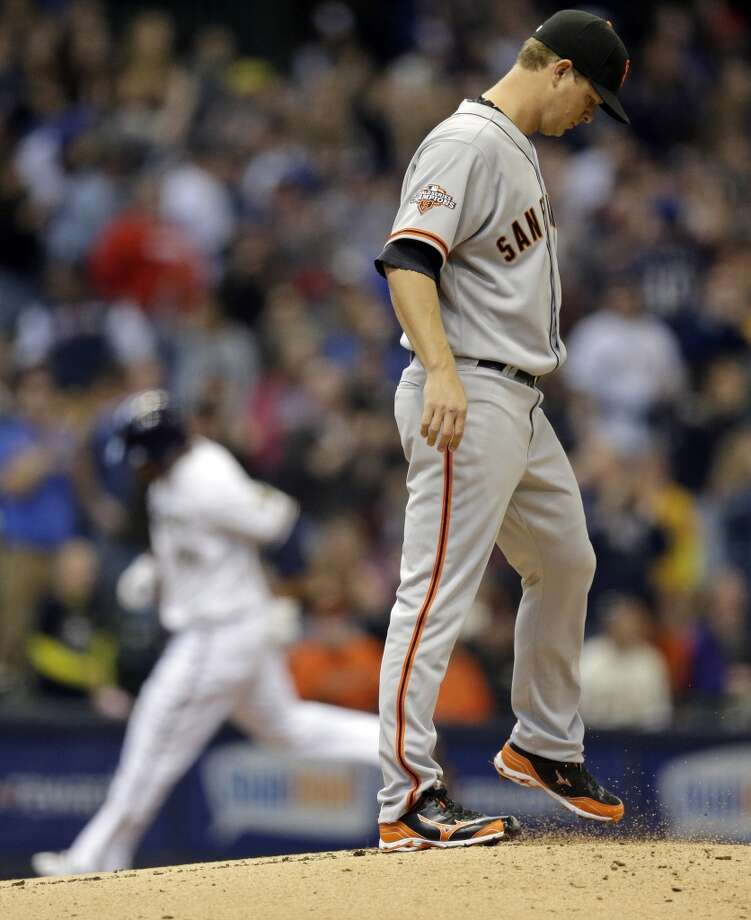 San Francisco Giants starting pitcher Matt Cain kicks up some dirt on the mound as Milwaukee Brewers\' Yovani Gallardo rounds the bases after hitting a two-run home run during the second inning of a baseball game Thursday, April 18, 2013, in Milwaukee.
