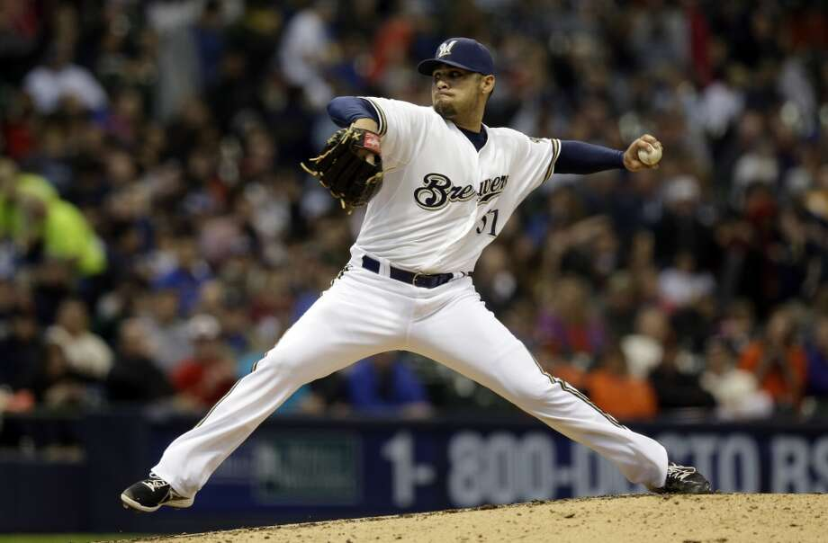 Milwaukee Brewers\' Mike Gonzalez throws during the seventh inning of a baseball game against the San Francisco Giants Thursday, April 18, 2013, in Milwaukee.