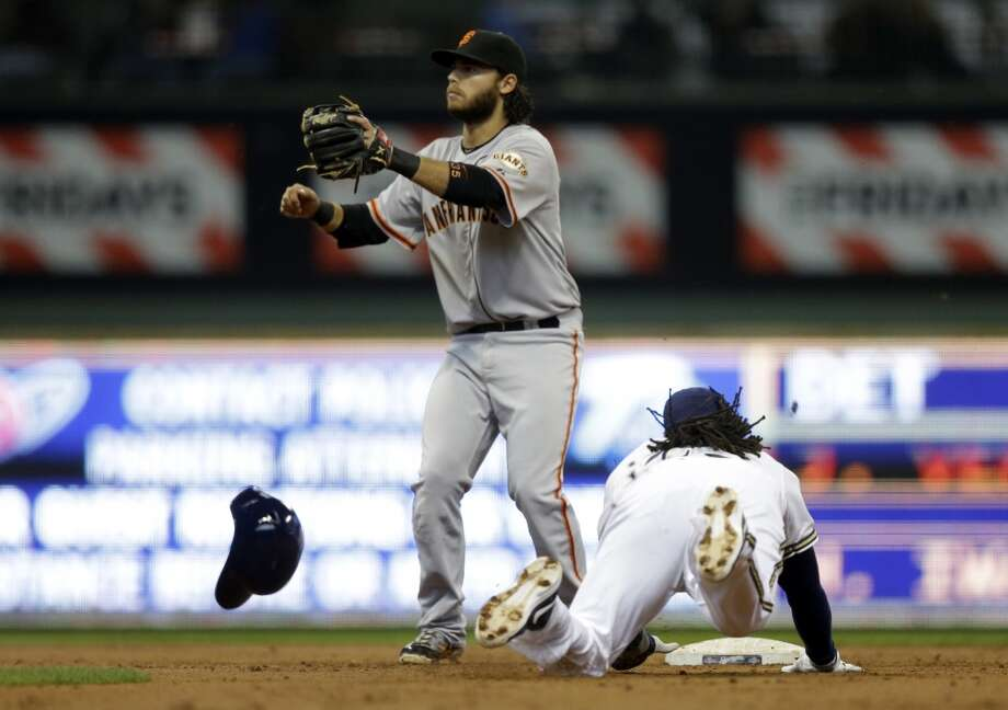 Milwaukee Brewers\' Rickie Weeks steals second with San Francisco Giants\' Brandon Crawford covering during the third inning of a baseball game Thursday, April 18, 2013, in Milwaukee.