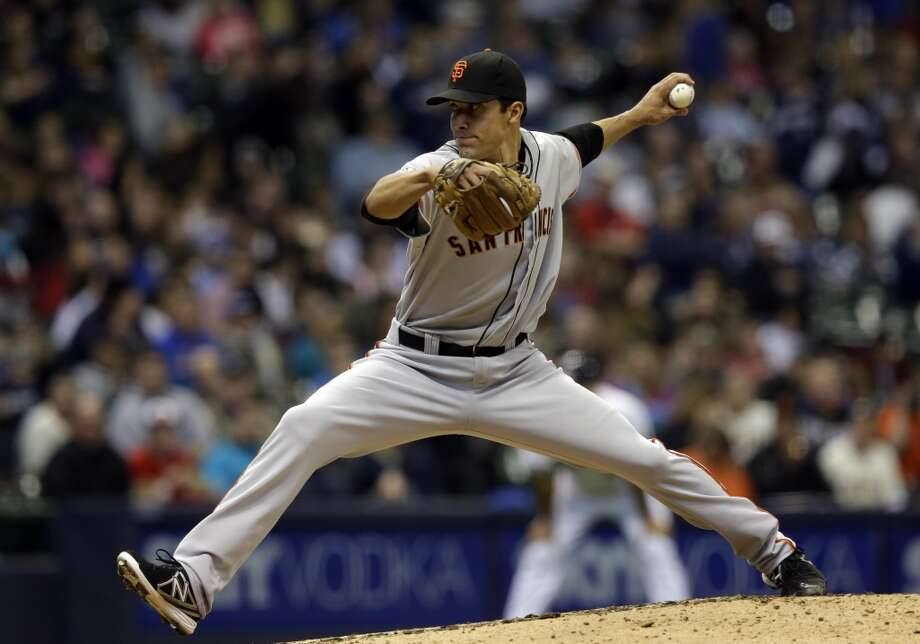 San Francisco Giants\' Javier Lopez throws during the seventh inning of a baseball game against the Milwaukee Brewers Thursday, April 18, 2013, in Milwaukee.