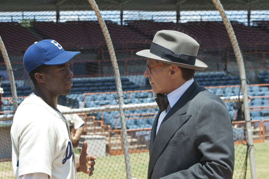 "Chadwick Boseman, left, as Jackie Robinson, and Harrison Ford as Branch Rickey in ""42"""