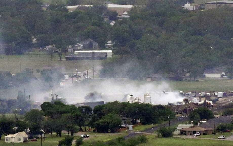 The remains of the the fertilizer plant smolder in West. Photo: Tony Gutierrez, STF / AP