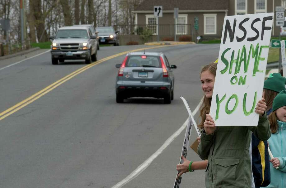 Eliza Eggleston, age 16, of Newtown, Conn, a member of the Newtown Action Alliance Junior Chapter, joined members of Second Amendment Sanity (SAS), in protesting in front of the National Shooting Sports Foundation at 11 Mile High Road, Newtown, Conn on Thursday, April 18th, 2013. Photo: H John Voorhees III