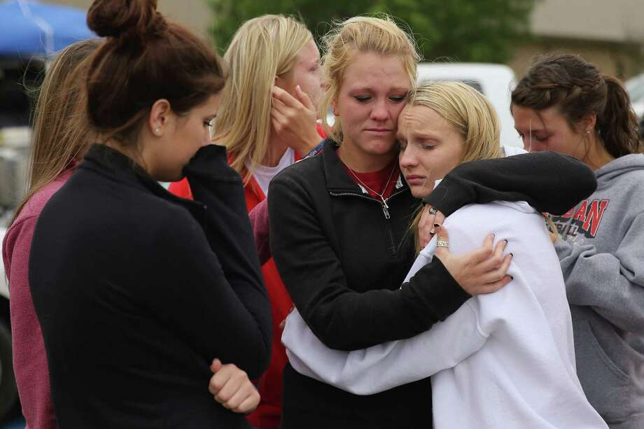 WEST, TX - APRIL 18:  West High School senior students Kelsey Hoelscher (C) and Heather Perry (R) embrace after praying for the victims and survivors the day after the West Fertilizer Company explosion April 18, 2013 in West, Texas. Hoelscher's uncles, Bob Snokhous and Doug Snokhous, were volunteer fire fighters who are presumed dead after the fertilizer company caught fire and exploded, injuring more than 160 people and leaving damaged buildings for blocks in every direction. (Photo by Chip Somodevilla/Getty Images)  *** BESTPIX *** Photo: Chip Somodevilla, Getty Images / 2013 Getty Images