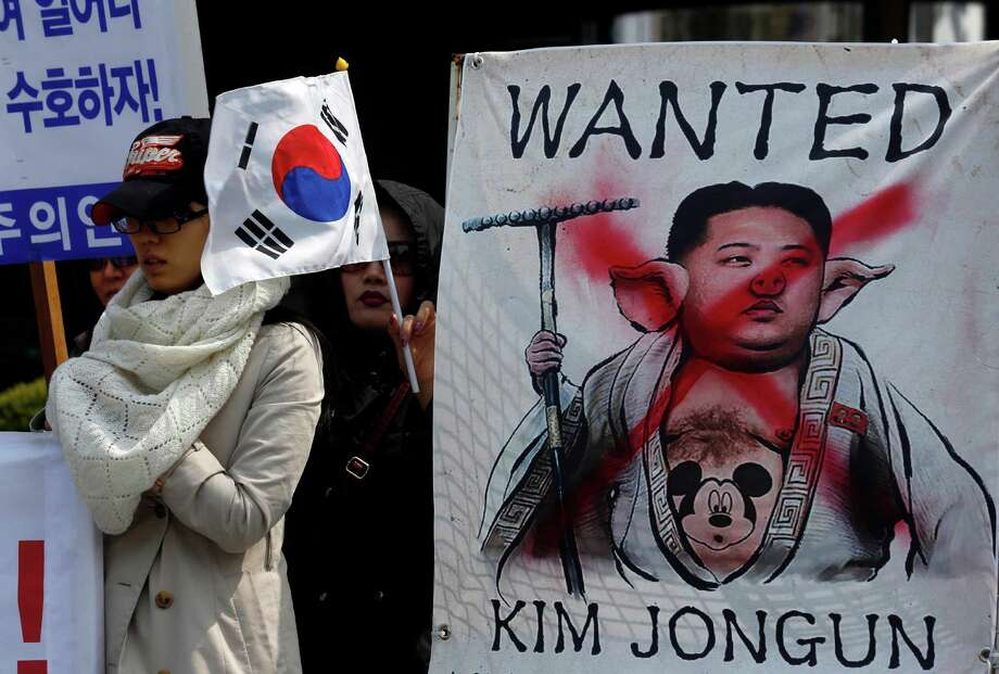 A defaced image of North Korean leader Kim Jong Un was prominent at a South Korean protest rally in downtown Seoul on Thursday. Photo: Kin Cheung, STF / AP