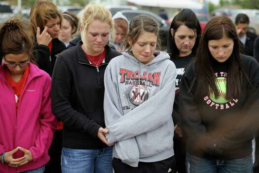 WEST, TX - APRIL 18:  West High School senior students (L-R) Brittany Singh, Kelsey Hoelscher, Ashton Uptmor and Nicole Hutyra pray for the victims and survivors the day after the West Fertilizer Company explosion April 18, 2013 in West, Texas. Hoelscher's uncles, Bob and Doug Snokhous, were volunteer fire fighters who are presumed dead after the fertilizer company caught fire and exploded, injuring more than 160 people and leaving damaged buildings for blocks in every direction. Photo: Chip Somodevilla, Getty Images / 2013 Getty Images