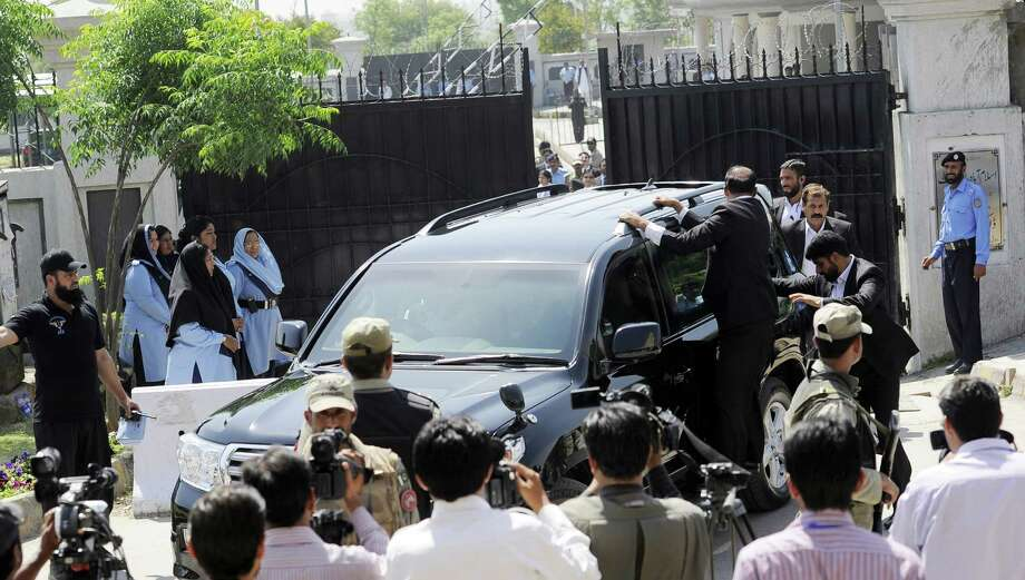 Pakistani special security commandos escort a vehicle carrying former military ruler Pervez Musharraf as he flees the court premises after an order was made for his arrest Thursday in Islamabad. Photo: STR, Stringer / AFP