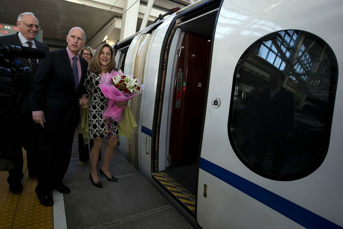 California Gov. Jerry Brown, center left, and his wife Anne Brown, center, prepare to board a high speed rail leaving from the Beijing South train station in Beijing, China, Thursday, April 11, 2013. Brown highlighted his state's interest in infrastructure by traveling on China's high-speed rail system, which is the longest in the world. (AP Photo/Ng Han Guan)