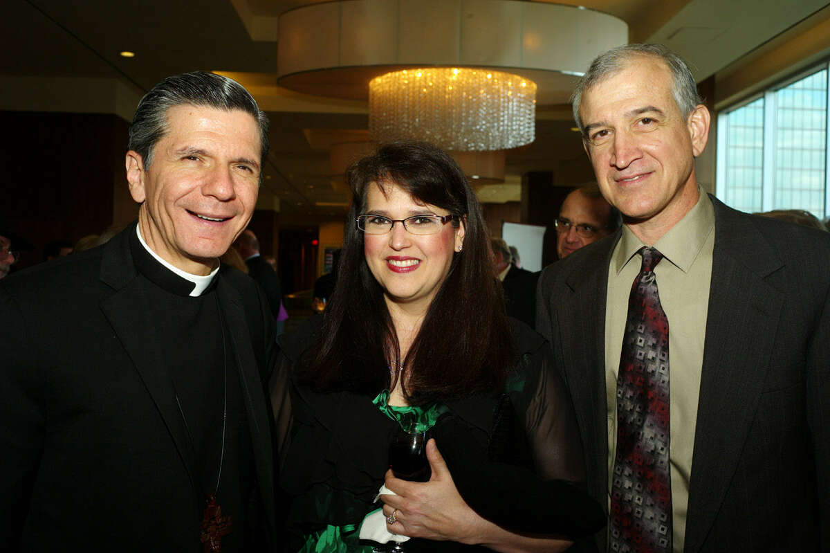 Archbishop Gustavo Garcia-Siller (from left) and Debbie and Adrian Cavallini