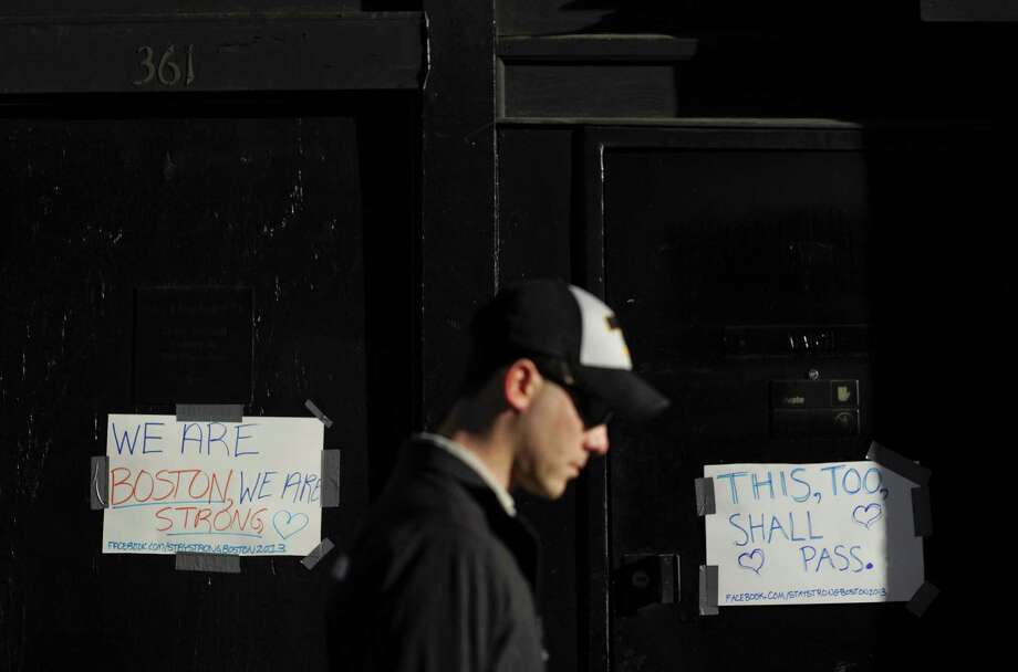 Inspirational messages are posted in downtown Boston. The American free speech tradition has kept violence at a minimum compared to the 1960s and 1970s. Photo: Gretchen Ertl, New York Times