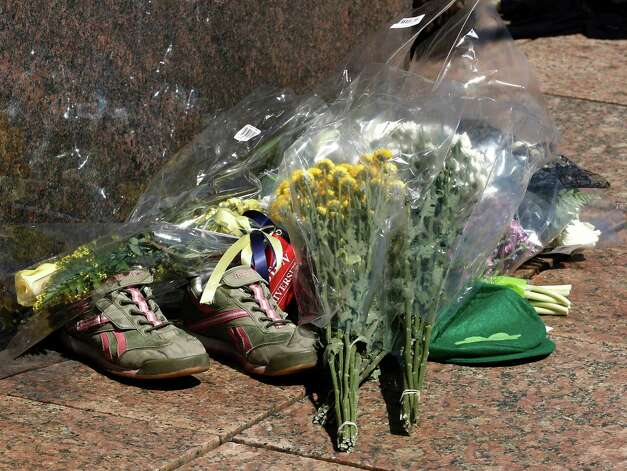 A makeshift memorial including a pair of running shoes sits on the campus of Boston University after it was learned that BU student Lu Lingzi was one of the victims of the Boston Marathon bombings in Boston Wednesday, April 17, 2013. Photo: Winslow Townson