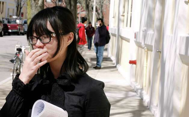 A Boston University student who knew Boston Marathon bombing victim Lu Lingzi pauses while talking about her friend outside the Boston University School of Mathematics and Statistics in Boston Wednesday, April 17, 2013. Photo: Winslow Townson