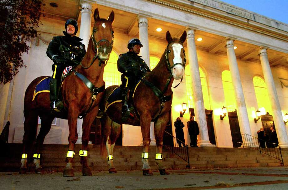 Bridgeport Police Officer Brian Grabinski on his horse General Lee, left, and Officer Herbie Mack on Amigo, patrol outside the Bill Finch Inauguration ceremony in 2007. Photo: File Photo / Connecticut Post File Photo Whitney Kidder-Alvarez/Connecticut Post
