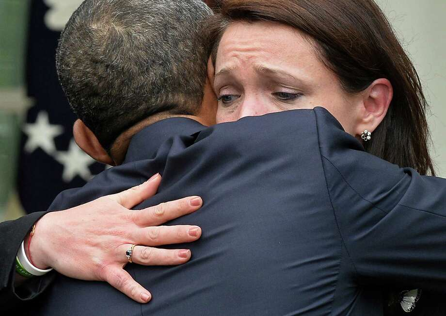 Nicole Hockley, whose son Dylan was one of the Newtown shooting victims, gets a supportive embrace from President Barack Obama after he addressed the gun control impasse Thursday at the White House. Photo: JEWEL SAMAD, Staff / AFP