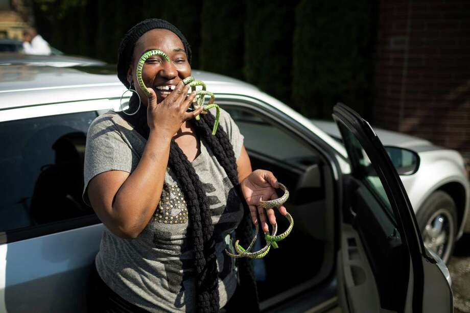 Cassandra Moore, who may have the longest fingernails in Washington State, is shown April 16, 2013, on Queen Anne. Photo: JORDAN STEAD, SEATTLEPI.COM / SEATTLEPI.COM