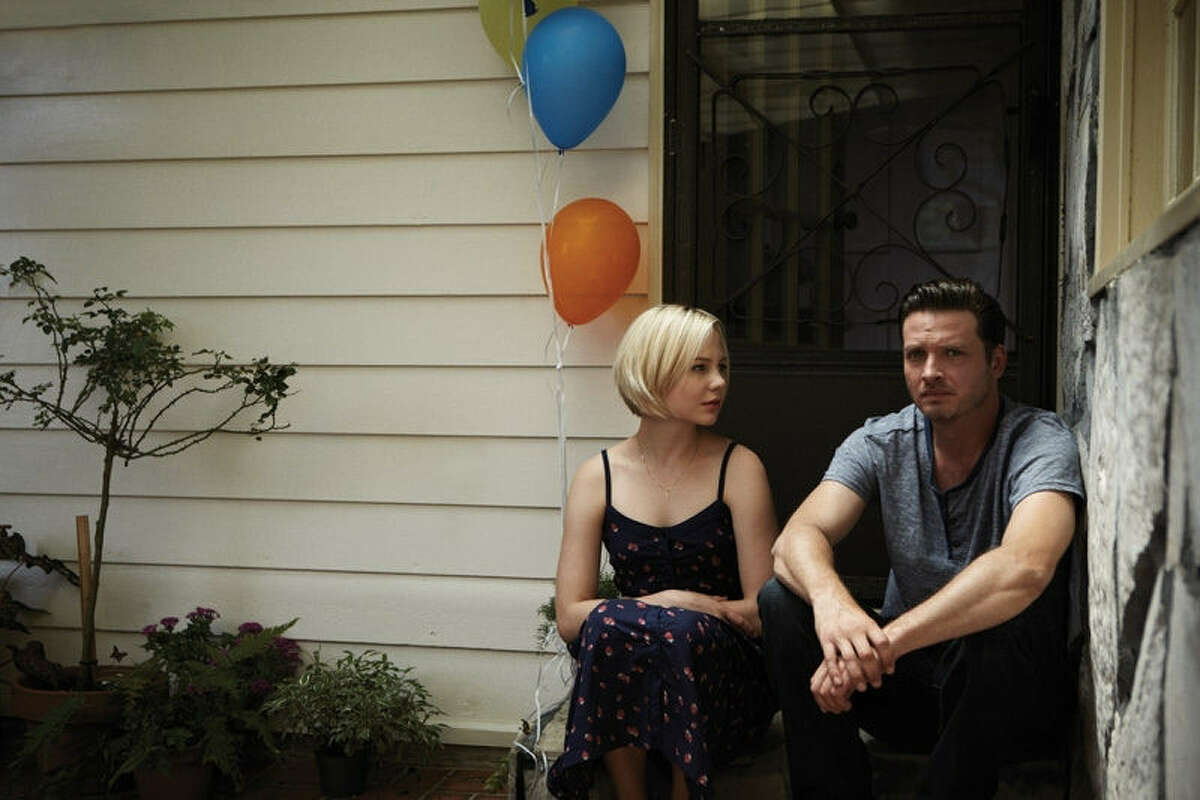 Daniel Holden (Aden Young), recently released from prison, shares a quiet moment with his stepbrother's wife (Adelaide Clemens) in the Sundance drama