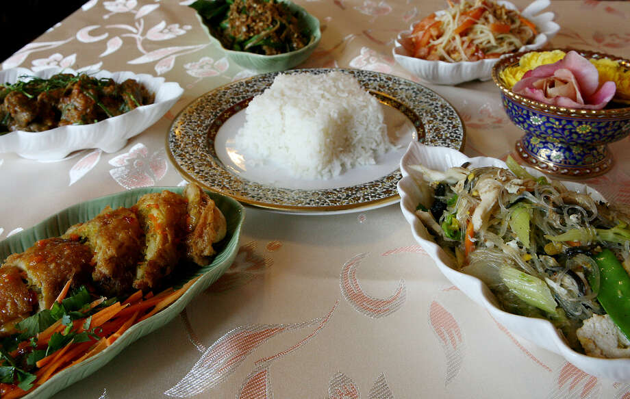 An assortment of the offerings at Bangkok Cuisine: Golden Wings (clockwise from left), pad ped, pla pad prik, som tum and pad woon sen. Photo: Photos By Cynthia Esparza / For The Express-News