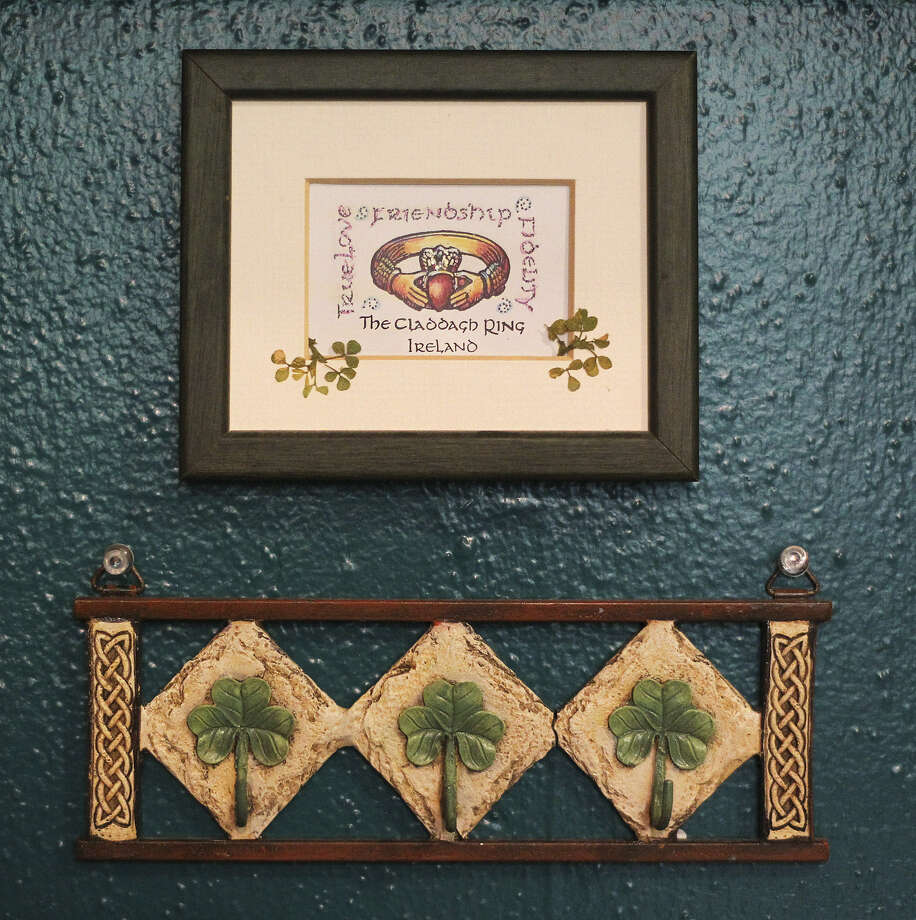 Irish trinkets hang on a wall in the kitchen.