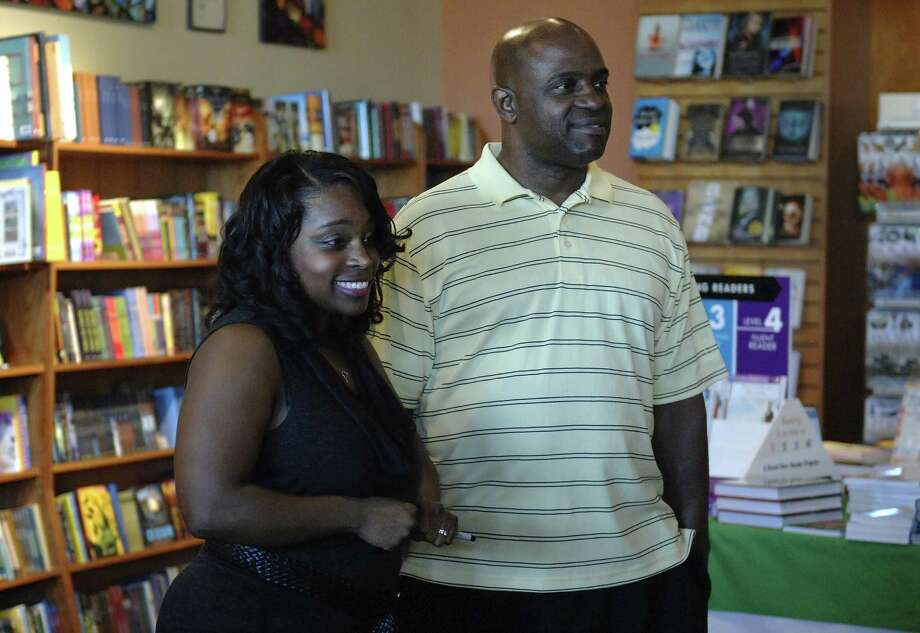 "Former San Antonio Express-News staff writer Tunette Powell, with her father, Bruce Callis, fields questions about her book, ""The Other Woman,"" which details her life as a child of a drug addict-prison inmate. The gathering was at The Twig Book Shop. Photo: Steve Faulisi / San Antonio Express-News"