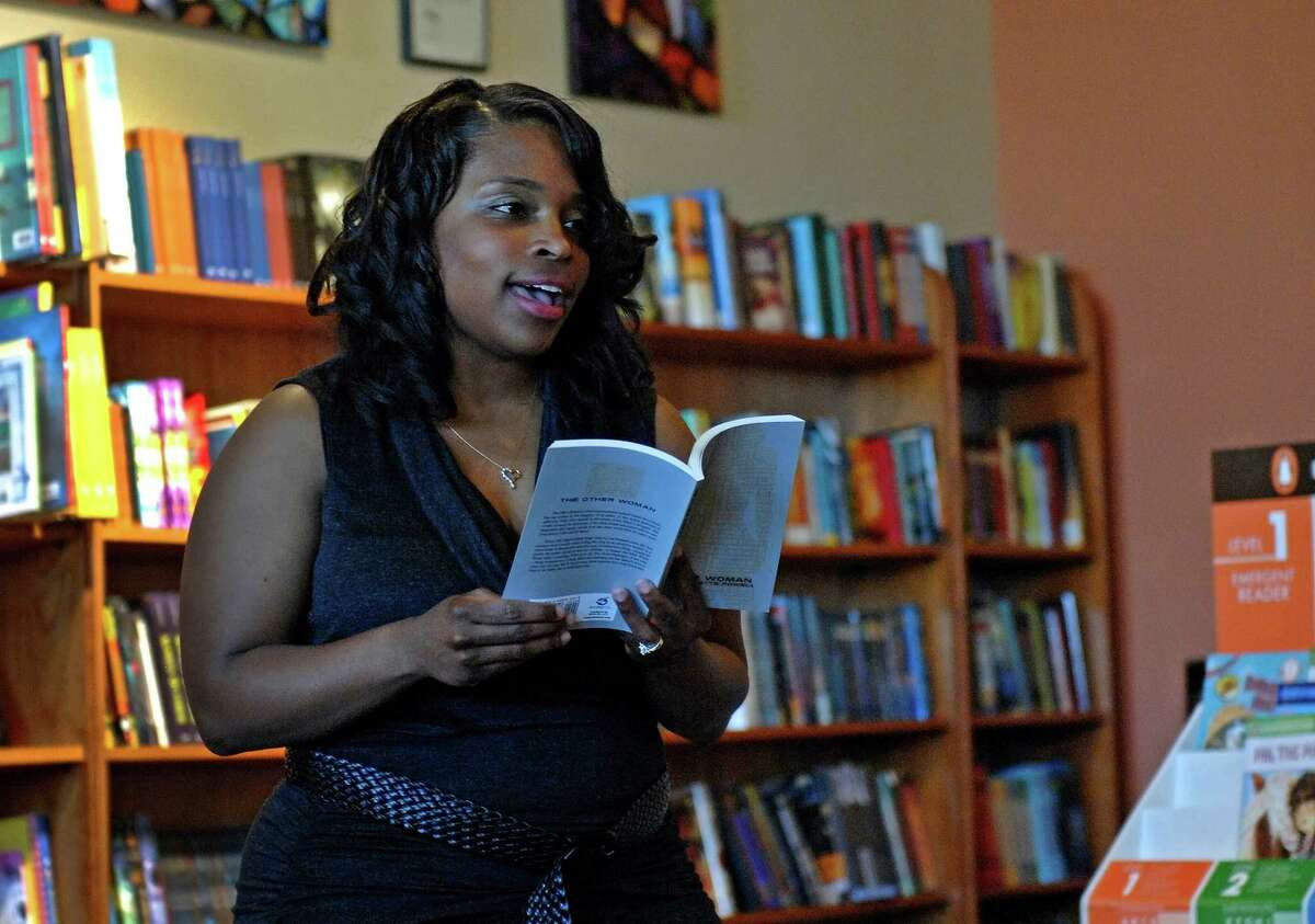 Former San Antonio Express-News staff writer Tunette Powell reads a passage from her book