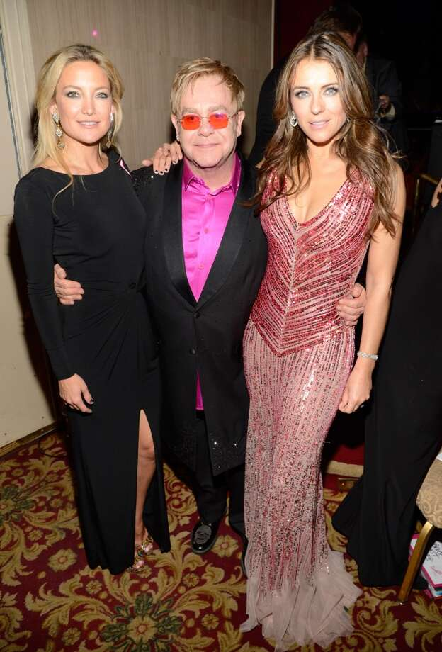 Kate Hudson, Elton John and Elizabeth Hurley attend the Breast Cancer Foundation\'s Hot Pink Party at the Waldorf Astoria Hotel on April 17, 2013 in New York City.  (Photo by Kevin Mazur/WireImage)