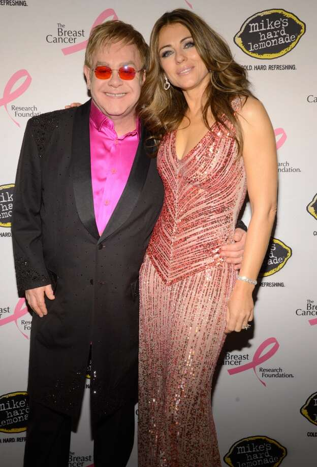 Elton John and Elizabeth Hurley attend the Breast Cancer Foundation\'s Hot Pink Party at the Waldorf Astoria Hotel on April 17, 2013 in New York City.  (Photo by Kevin Mazur/WireImage)
